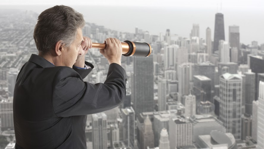 Business concept.  Business man looks through a telescope